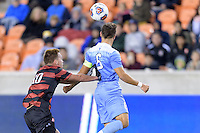 Houston, TX - Friday December 9, 2016: Corey Baird (10) of the Stanford Cardinal attempts to push Colton Storm (6) of the North Carolina Tar Heels away from the ball at the NCAA Men's Soccer Semifinals at BBVA Compass Stadium in Houston Texas.