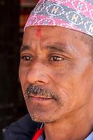 Nepal, Patan.  Nepalese Man Wearing a Nepali Hat (Dhaka Topi).