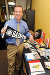 Colin Hageney stands by some of the items that  his company has designed at Bullpen Marketing Tuesday Feb. 26, 2013.(Dave Rossman/ For the Chronicle)