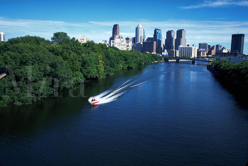 Speedboat in Schuylkill River, skyline of Philadelphia in background, Pennsylvania