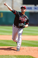 Lansing Lugnuts pitcher Roberto Osuna #24 pitches during a game against the Cedar Rapids Kernels at Veterans Memorial Stadium on April 30, 2013 in Cedar Rapids, Iowa. (Brace Hemmelgarn/Four Seam Images)