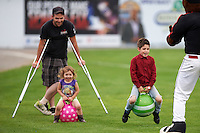 Batavia Muckdogs young fans partake in an on field promotion during a game against the Williamsport Crosscutters on August 29, 2015 at Dwyer Stadium in Batavia, New York.  Williamsport defeated Batavia 7-3.  (Mike Janes/Four Seam Images)
