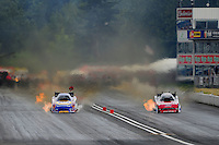 Aug. 6, 2011; Kent, WA, USA; NHRA funny car driver Ron Capps (left) races alongside Bob Tasca III during qualifying for the Northwest Nationals at Pacific Raceways. Mandatory Credit: Mark J. Rebilas-
