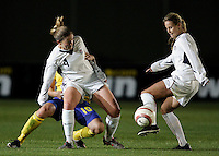 Cat Whitehill passes the ball off to Leslie Osborne at the VRS Antonio Stadium in VRS Antonio, March 12, 2007, during the Algarve Women´s Cup soccer match between USA and Sweden. USA won 3-2.