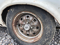 BNPS.co.uk (01202) 558833. <br /> Pic: Charterhouse/BNPS<br /> <br /> Pictured: Rusty rims. <br /> <br /> A clapped-out Ford Escort which has been languishing in a garage for nearly 25 years is tipped to sell for £25,000.<br /> <br /> The rare 1975 Mk 1 RS2000 model is in a rusty state and is in need of lots of care and attention.