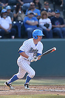 Brett Stephens #23 of the UCLA Bruins bats against the Cal Poly Mustangs at Jackie Robinson Stadium on February 22, 2014 in Los Angeles, California. Cal Poly defeated UCLA, 8-0. (Larry Goren/Four Seam Images)