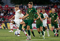 COLLEGE PARK, MD - SEPTEMBER 3: Maryland University defender Brett ST. Martin (12) clashes with George Mason University defender Noah McGrath (5) during a game between George Mason University and University of Maryland at Ludwig Field on September 3, 2021 in College Park, Maryland.
