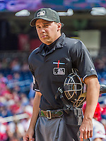 20 September 2015: MLB Umpire Adam Hamari works home plate during a game between the Miami Marlins and the Washington Nationals at Nationals Park in Washington, DC. The Marlins fell to the Nationals 13-3 in the final game of their 4-game series. Mandatory Credit: Ed Wolfstein Photo *** RAW (NEF) Image File Available ***