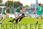 Ciaran Kennedy, Mid Kerry in action against Kieran O'Leary, Dr. Crokes during the Kerry County Senior Football Championship Semi-Final match between Mid Kerry and Dr Crokes at Austin Stack Park in Tralee, Kerry.