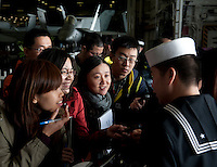 111227-N-DR144-425 HONG KONG (Dec. 27, 2011) Hospitalman Joseph Yu, assigned to Medical Department, speaks to members of the Hong Kong press in Cantonese during a media tour of Nimitz-class aircraft carrier USS Carl Vinson (CVN 70). The Carl Vinson Strike Group is currently anchored in Hong Kong Harbor for a port visit.  (U.S. Navy photo by Mass Communication Specialist 2nd Class James R. Evans/Released)