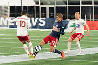 FOXBOROUGH, MA - OCTOBER 16: Arturo Rodriguez #10 of North Texas SC tackles Justin Rennicks #12 of New England Revolution II during a game between North Texas SC and New England Revolution II at Gillette Stadium on October 16, 2020 in Foxborough, Massachusetts.