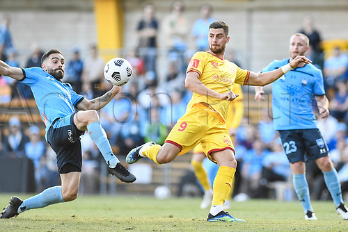 18th April 2021; Leichardt Oval, Sydney, New South Wales, Australia; A League Football, Sydney Football Club versus Adelaide United; Tomi Juric of Adelaide United waits for the ball to drop and shoot as Anthony Caceres of Sydney intercepts