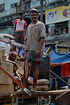 Mohan Singh a migrant labour from Bihar now works as goods carrier at Burrabazzar in  Kolkata.West Bengal, India, 2009. Arindam Mukherjee