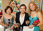 From left: Ceanna Hsieh, Viet Hoang and Grace Jacobson at  a reception at the home of Jereann Cheney announcing the Houston exhibition of Ai Weiwei's Circle of Animals / Zodiac HeadsWednesday May 25,2011.(Dave Rossman/For the Chronicle)