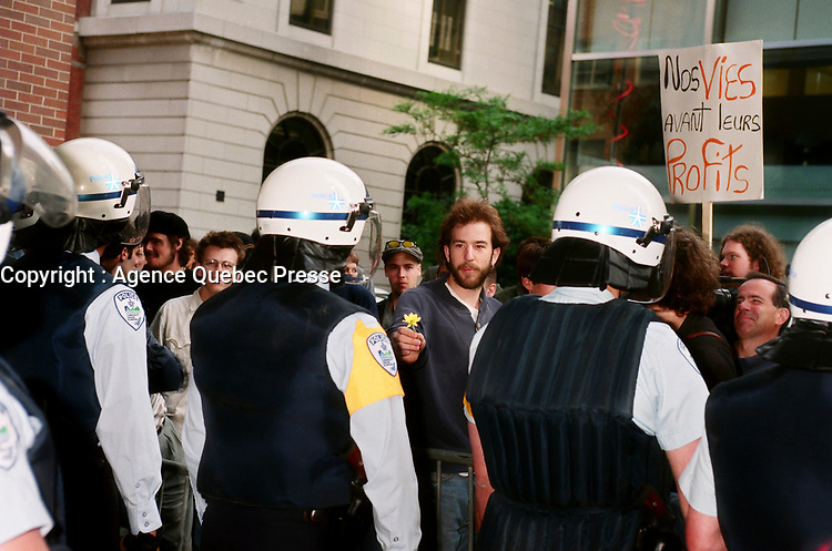 Montreal (Qc) CANADA - May 1998 File Photo-<br /> Montreal city Policemen,watch demonstrators outside the Sheraton Hotel where the Conference of Montreal is taking place.<br /> <br /> <br /> PHOTO :  Agence Quebec Presse