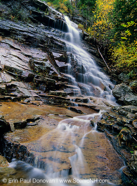 Silver Cascade in Crawford Notch State Park in Hart's Location, New Hampshire during the autumn months. This roadside waterfall is a big tourist attraction.