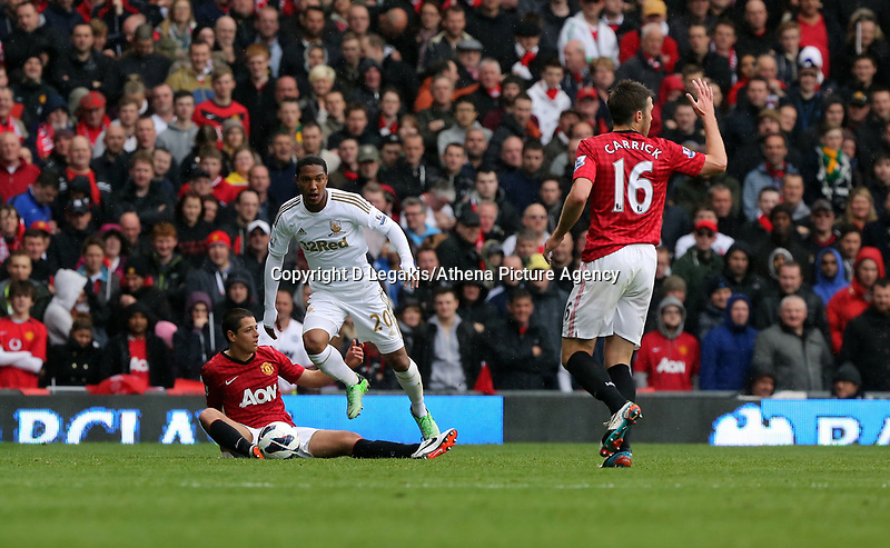 Pictured: (L-R) Jonathan de Guzman, Michael Carrick.<br /> Sunday 12 May 2013<br /> Re: Barclay's Premier League, Manchester City FC v Swansea City FC at the Old Trafford Stadium, Manchester.