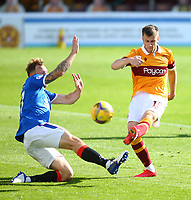27th September 2020; Fir Park, Motherwell, North Lanarkshire, Scotland; Scottish Premiership Football, Motherwell versus Rangers; Scott Arfield of Rangers tries to block a shot from Liam Polworth of Motherwell