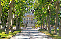 The Chateau Margaux built in 1802 19th century by the architect Combes, with black iron gate and tree lined allee road Margaux Medoc Bordeaux Gironde Aquitaine France