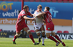 Guiness Pro12<br /> No way through for Ulster flanker Chris Henry as Scarlets centre Scott Williams and lock Joe Snyman close in.<br /> Scarlets v Ulster<br /> Parc y Scarlets<br /> <br /> 06.09.14<br /> ©Steve Pope-SPORTINGWALES