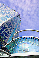 Looking up at business buildings and seeing blue sky
