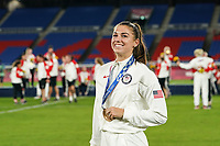 YOKOHAMA, JAPAN - AUGUST 6: Alex Morgan #13 of the United States pose for a picture with her bronze medal during the ceremony at International Stadium Yokohama on August 6, 2021 in Yokohama, Japan.