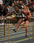 SPEARFISH, S.D. -- FEBRUARY 23, 2013 -- Ackiesha Burnette of Adams State leaps the last hurdle on her way to winning the women's 60m hurdle event Saturday during the 2013 RMAC Men's and Women's Track and Field Championships at the Donald Young Center on the campus of Black Hills State University.    (Photo by Richard Carlson/dakotapress.org)