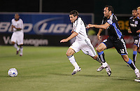Dema Kovalenko (8) and Ramiro Corrales (12) chase down the ball. San Jose Earthquakes tied Los Angeles Galaxy 1-1 at the McAfee Colisum in Oakland, California on April 18, 2009.