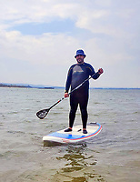BNPS.co.uk (01202) 558833.<br /> Pic: Cenk Albayrak-Touye/BNPS<br /> <br /> PICTURED: Cenk Albayrak-Touye on his paddle-board<br /> <br /> WITH VIDEO https://www.youtube.com/watch?v=mlDRZXQkDnM<br /> <br /> A paddle-boarder got the surprise of his life when a seal hopped on board for a ride. <br /> <br /> The chilled-out animal made its way on to the board before spending a couple of minutes basking in the sun. <br /> <br /> It seemed oblivious to its host - amazed novice paddle-boarder Cenk Albayrak-Touye – for most of the time it spent relaxing on his board. <br /> <br /> But it then turned round and had a good look at him before slipping back into the sea.