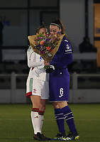 Lenie Onzia (8) of OHL gives the bouquet of flowers to Tine De Caigny (6) of Anderlecht during a female soccer game between Oud Heverlee Leuven and RSC Anderlecht on the 12 th matchday of the 2020 - 2021 season of Belgian Womens Super League , sunday 31 st of January 2021  in Heverlee , Belgium . PHOTO SPORTPIX.BE | SPP | SEVIL OKTEM