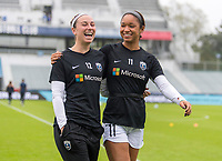CARY, NC - OCTOBER 20: Morgan Andrews #12 and Darian Jenkins #11 of Reign FC walk off the field during a game between Reign FC and North Carolina Courage at Sahlen's Stadium at WakeMed Soccer Park on October 20, 2019 in Cary, North Carolina.