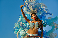 A Colombian girl, having a blue feather costume, performs on the top of the allegorical float during the Carnival in Barranquilla, Colombia, 27 February 2006. The Carnival of Barranquilla is a unique festivity which takes place every year during February or March on the Caribbean coast of Colombia. A colourful mixture of the ancient African tribal dances and the Spanish music influence - cumbia, porro, mapale, puya, congo among others - hit for five days nearly all central streets of Barranquilla. Those traditions kept for centuries by Black African slaves have had the great impact on Colombian culture and Colombian society. In November 2003 the Carnival of Barranquilla was proclaimed as the Masterpiece of the Oral and Intangible Heritage of Humanity by UNESCO.