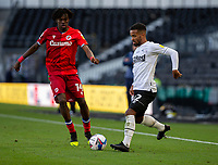 12th September 2020; Pride Park, Derby, East Midlands; English Championship Football, Derby County versus Reading; Nathan Byrne of Derby County passing the ball back as he comes under pressure from Ovie Ejaria of Reading