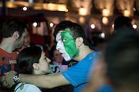 01/07/2012 Finale dei campionati europei di calcio 2012  Italia - Spagna: delusione dei tifosi in piazza a Torino. Un ragazzo con la faccia dipinta con i colori della bandiera italiana abbraccia una ragazza,