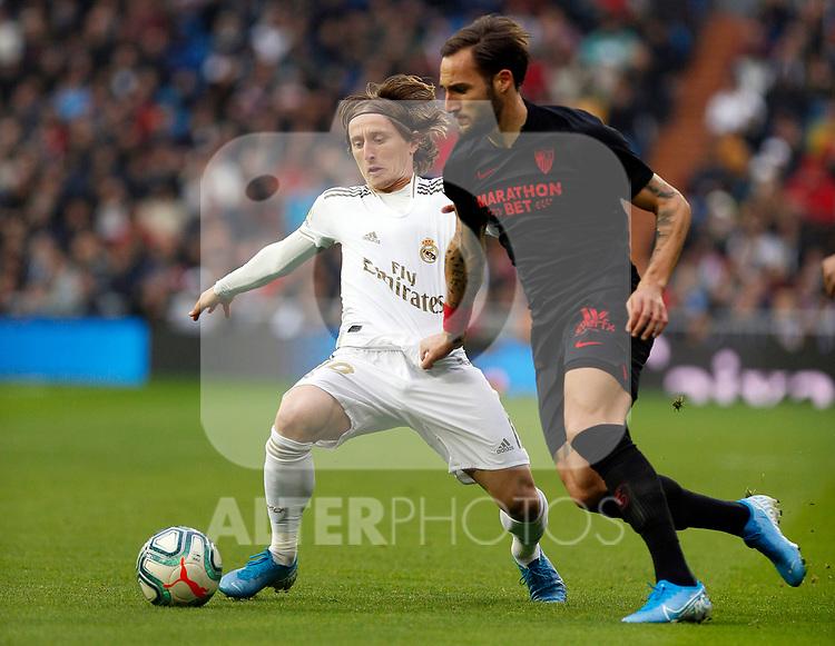 Real Madrid CF's Luka Modric and Sevilla FC's Nemanja Gudelj competes for the ball during the Spanish La Liga match round 20 between Real Madrid and Granada CF at Santiago Bernabeu Stadium in Madrid, Spain