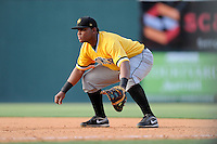 First baseman Edwin Espinal (14) of the West Virginia Power in a game against the Greenville Drive on Sunday, May 11, 2014, at Fluor Field at the West End in Greenville, South Carolina. Greenville won, 9-6. (Tom Priddy/Four Seam Images)