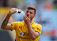 Patrick Cutrone of Wolves sprays water onto his face during the 2021/22 pre season friendly match between Coventry City and Wolverhampton Wanderers at the Coventry Building Society Arena, Coventry, England on the 1 August 2021. Photo by Andy Rowland.