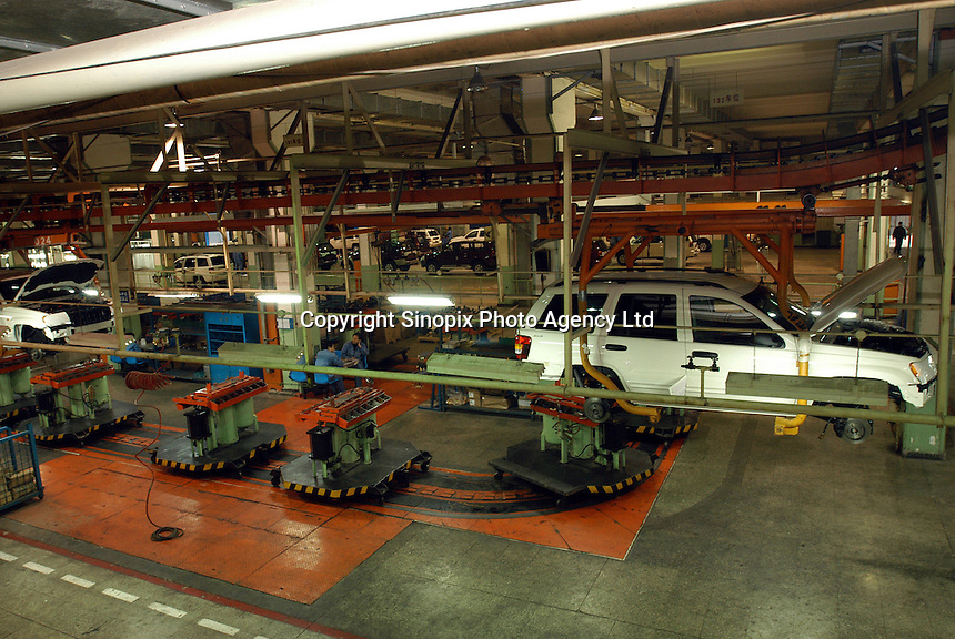 """The production line of """"Grand Cherokee"""" of Chrysler in the Beijing Jeep factory.."""