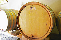 The barrel aging cellar with large oak barrels (demi muids) containing 600 litres as opposed to the usual size of 225 l. Detail.  Domaine du Colombier, Crozes-Hermitage, Mercurol, Drome Drôme, France Europe