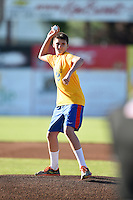 Representative from Perry Elementary School throws out the first pitch before Batavia Muckdogs game against the Mahoning Valley Scrappers on June 23, 2015 at Dwyer Stadium in Batavia, New York.  Mahoning Valley defeated Batavia 11-2.  (Mike Janes/Four Seam Images)