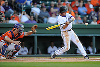 Outfielder Will Muzika (2) of the Furman Paladins bats in a game against the Clemson Tigers on Wednesday, May 8, 2013, at Fluor Field at the West End in Greenville, South Carolina. (Tom Priddy/Four Seam Images)