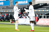 Sunday 18 March 2018<br /> Pictured:  Botti Biabi of Swansea City celebrates scoring his sides first goal of the match with George Byers<br /> Re: Swansea City v Manchester United U23s in the Premier League 2 at The Liberty Stadium on March 18, 2018 in Swansea, Wales.