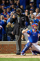 Umpire Tony Randazzo calls Brandon Guyer (not shown) out on strikes in the fifth inning during Game 5 of the Major League Baseball World Series against the Chicago Cubs on October 30, 2016 at Wrigley Field in Chicago, Illinois.  (Mike Janes/Four Seam Images)