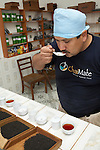 A technician sampling tea flavor in Chimate, a small community in the fertile Yungas region of Bolivia.