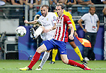 Real Madrid's Karim Benzema (l) and Atletico de Madrid's Diego Godin during UEFA Champions League 2015/2016 Final match.May 28,2016. (ALTERPHOTOS/Acero)