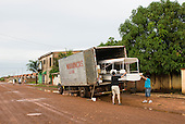 "Canarana, Mato Grosso, Brazil. Taking the boat ""Coração do Brasil"" out of the delivery truck."