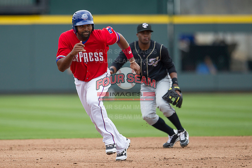 Round Rock Express designated hitter Joey Butler #16 runs to third base against the Omaha Storm Chasers in the Pacific Coast League baseball game on April 7, 2013 at the Dell Diamond in Round Rock, Texas. Omaha beat Round Rock 5-2, handing the Express their first loss of the season. (Andrew Woolley/Four Seam Images).