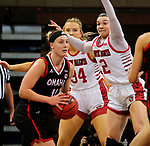 SIOUX FALLS, SD - MARCH 9: Claire Killian #11 of the Omaha Mavericks looks for help while being pressured by Liv Korngable #2 of the South Dakota Coyotes during the 2021 Women's Summit League Basketball Championship at the Sanford Pentagon in Sioux Falls, SD. (Photo by Dave Eggen/Inertia)