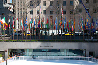 Rockefeller Center with flags and Rock Center Cafe over ice rink