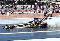Mar 30, 2014; Las Vegas, NV, USA; NHRA top fuel driver Tony Schumacher smokes the tires during the Summitracing.com Nationals at The Strip at Las Vegas Motor Speedway. Mandatory Credit: Mark J. Rebilas-
